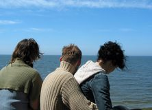 Three friends. Looking at the sea Royalty Free Stock Photos