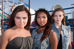 Three Friends at an Amusement Park Stock Images