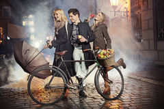 Three friends, apples and bicycle Stock Image