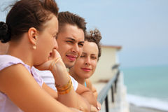 Three friends on balcony Royalty Free Stock Photography