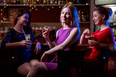 Three friends in the bar. Beauty three friends drinking cocktails in the bar Stock Photography