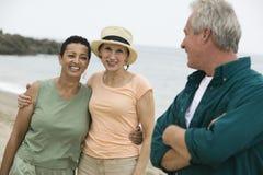 Three friends on beach Stock Photo