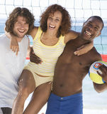 Three friends on a beach Stock Photography