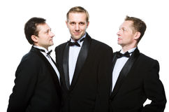 Three friends in a black tuxedo Royalty Free Stock Photo