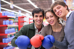 Three friends in boxing gloves Royalty Free Stock Images