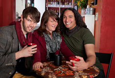 Three friends in a Coffee House Stock Photography