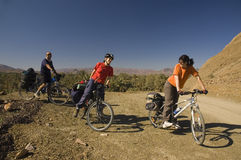 Three friends cycling in south Morocco Royalty Free Stock Photos