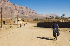 Three friends cycling in south Morocco Stock Photography