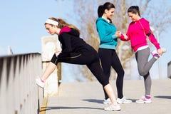 Three friends doing push-ups. Urban scene of Three friends doing push-ups royalty free stock photography