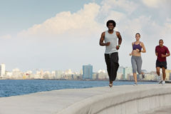 Three friends doing sport activities near the sea Royalty Free Stock Photos