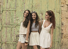 Three friends dressed in white Stock Photos