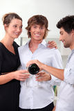 Three friends drinking champagne stock photos