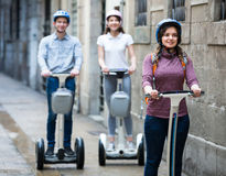 Three friends driving segways Royalty Free Stock Photography