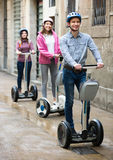 Three friends driving segways Royalty Free Stock Images