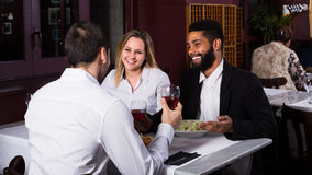 Three friends eating at restaurant Royalty Free Stock Image