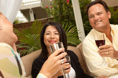 Three Friends Enjoying Wine on the Patio Royalty Free Stock Photos