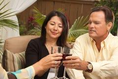 Three Friends Enjoying Wine on the Patio Stock Image