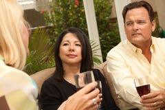 Three Friends Enjoying Wine on the Patio Royalty Free Stock Photos