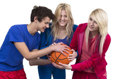 Three Friends Fighting For Basketball Stock Photo