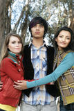 Three friends in forest. Three young friends in the forest Stock Photos