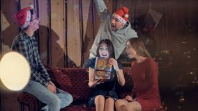 A woman receives a Christmas gift from her friends. stock footage