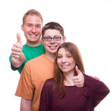 Three Friends giving OK and smiling Royalty Free Stock Photography