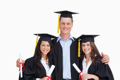 Three friends graduate from college together. Against a white background Royalty Free Stock Photography