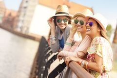Three friends hanging out in the city Stock Photo