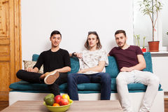 Three friends hanging out together in nice confortable room Stock Photography