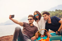 Three friends having fun at the beach, make selfie Royalty Free Stock Photo