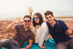 Three friends having fun at the beach, springtime Royalty Free Stock Images
