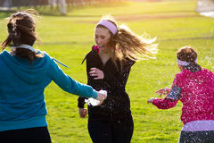 Three friends having fun after exercise Royalty Free Stock Image