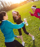 Three friends having fun after exercise Royalty Free Stock Photos
