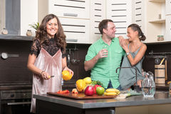 Three friends having fun in the kitchen Stock Photo