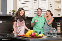 Three friends having fun in the kitchen Royalty Free Stock Photo