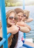 Three friends having a good time outdoors Royalty Free Stock Photos