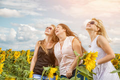Three friends having a good time outdoors Stock Images