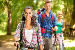 Three friends hiking Stock Image