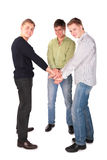 Three friends hold hands together Stock Image