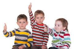 Three friends holding thumbs up Stock Photography