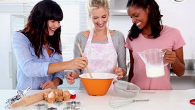 Three friends home baking together stock video