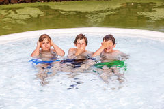 Three friends imitating the three wise monkeys Royalty Free Stock Images