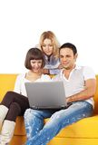 Three friends with laptop computer Stock Photo