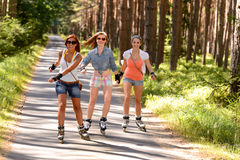 Three friends on in-line skates outdoor Stock Photo