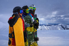 Three friends look forward snowboarders courageously Stock Images