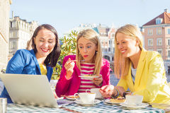 Three friends looking at computer Stock Image
