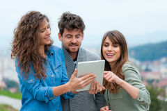 Three Friends looking at digital tablet Stock Photography