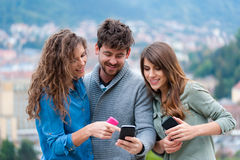 Three Friends looking at smartphone Royalty Free Stock Photos