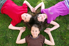 Three Friends Lying in the stock image