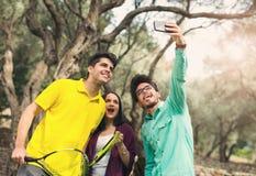 Three friends make selfi Stock Photos